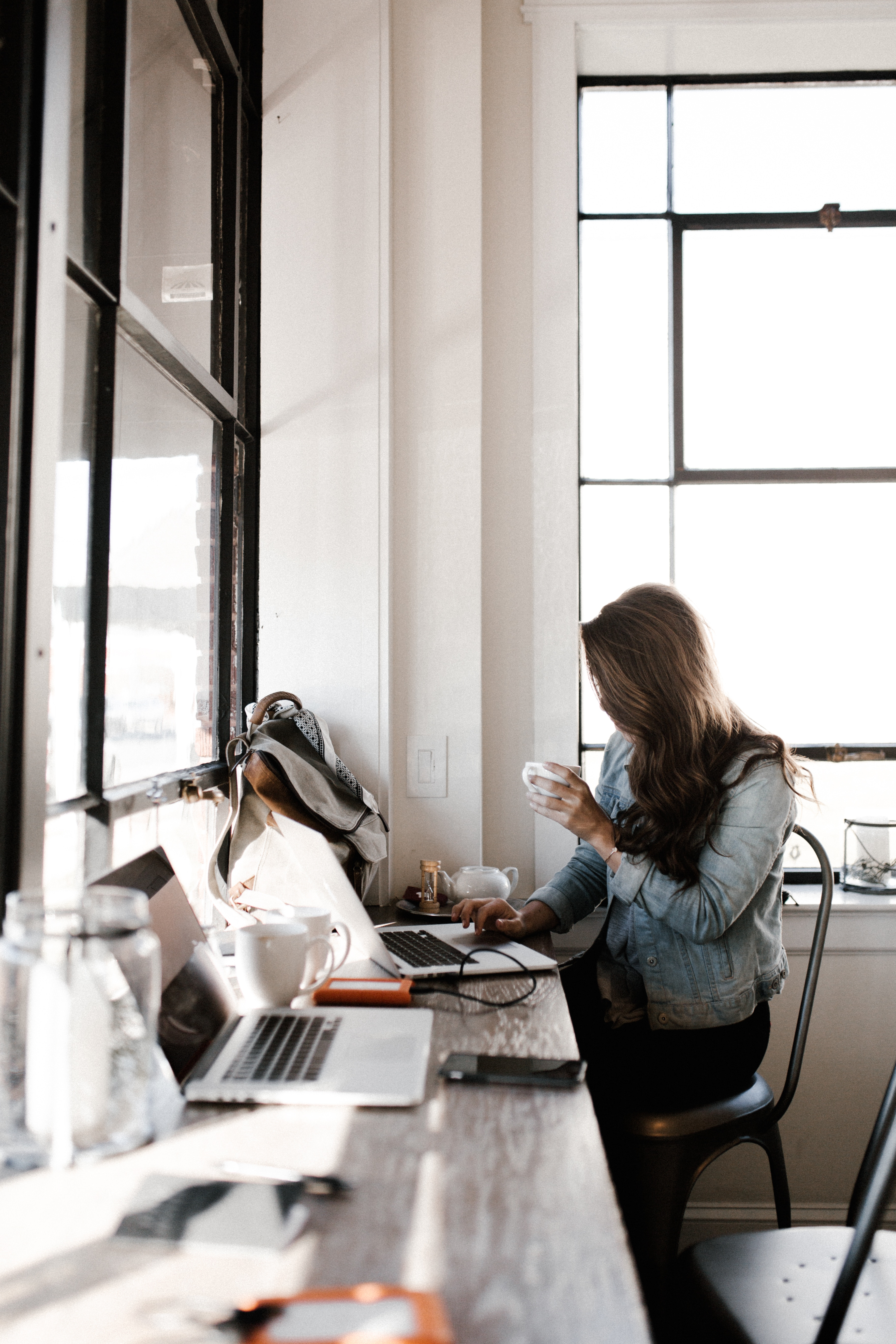 Woman at her desk for her business