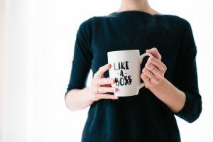Business lady with boss mug