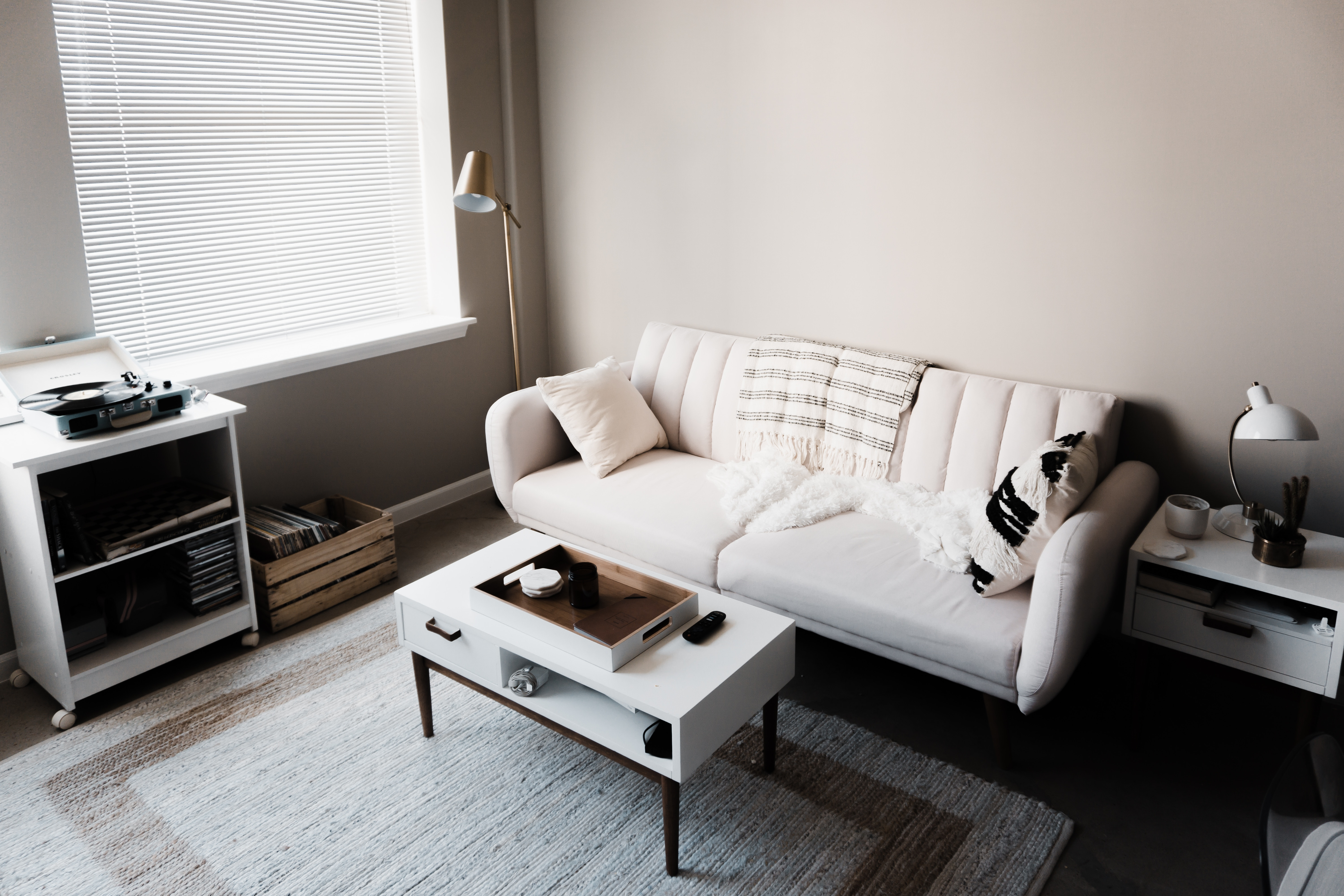 Inside main room of a home that has white walls and white furniture