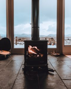 Stove in Glasgow holiday home with french doors behind it looking on to stunning views