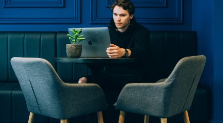 Man sitting at desk working knows too much sitting is bad for health