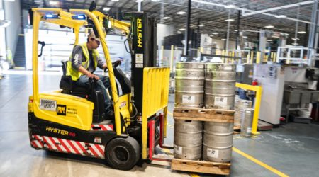 This is a hand forklift in action in a brewery.